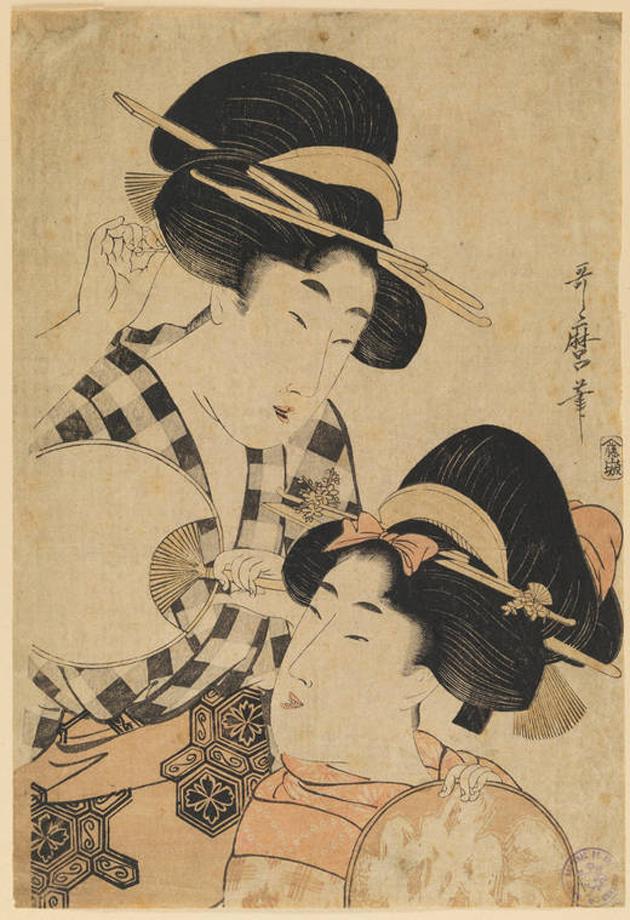 mujeres con abanico